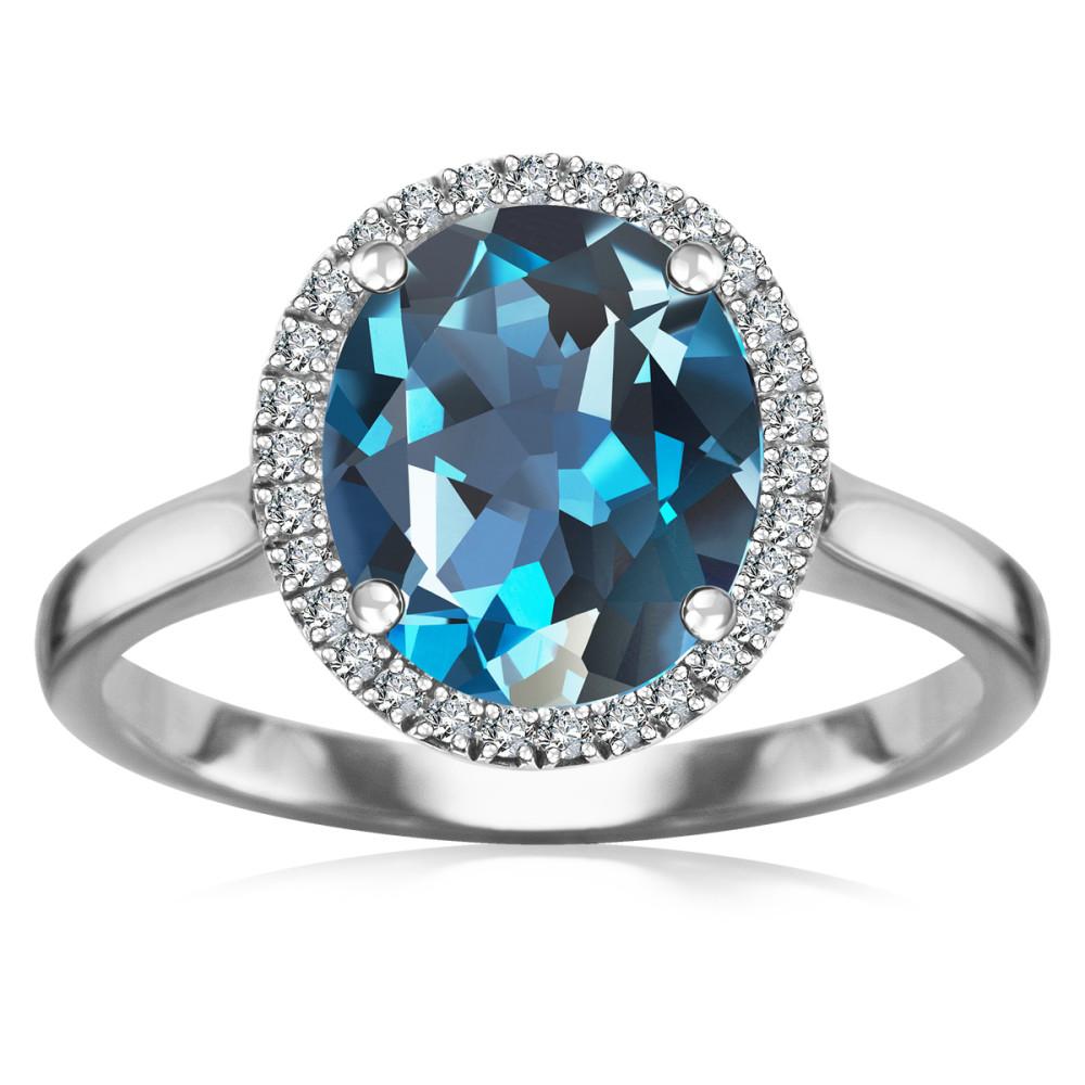 Złoty pierścionek z blue topazem 2195zł, yes.pl